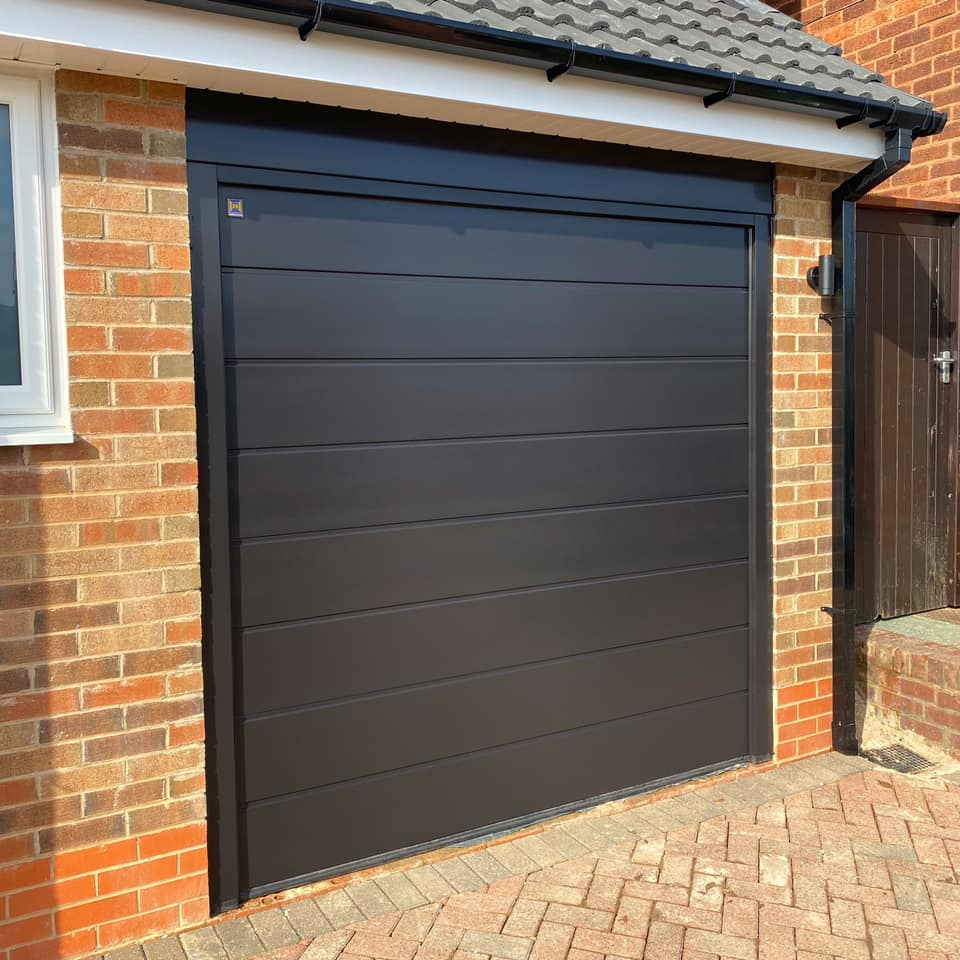 Need your garage door sprayed to match the rest of your house? We spray garage d...