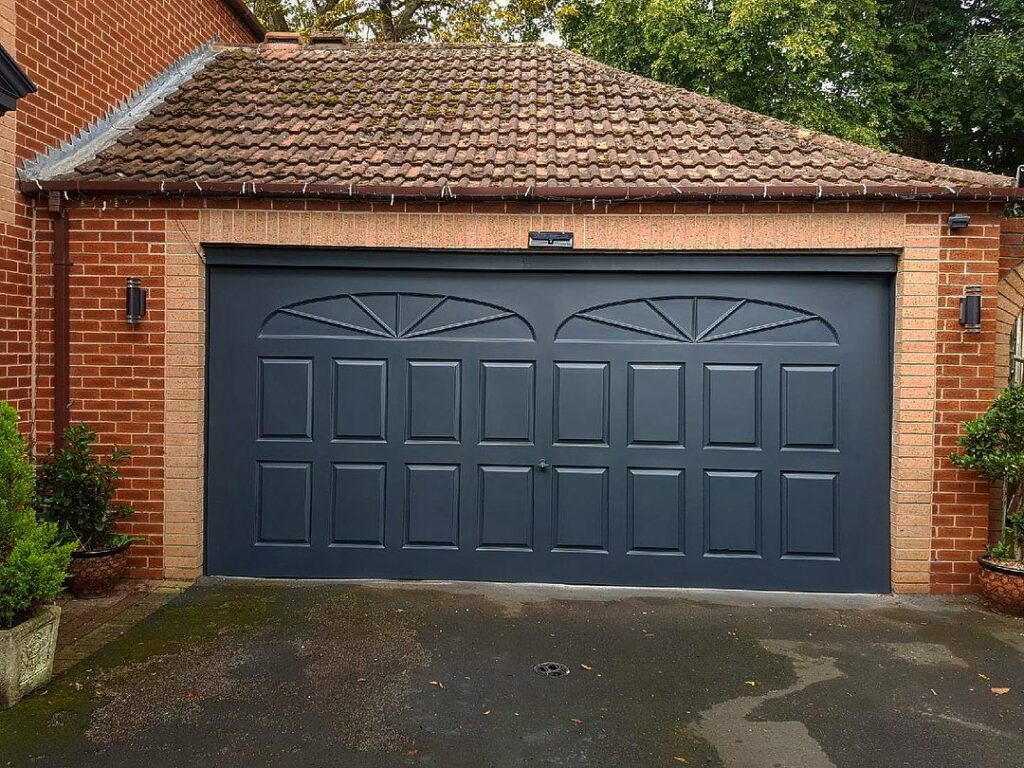 Thinking about replacing a garage door? Then THINK again....