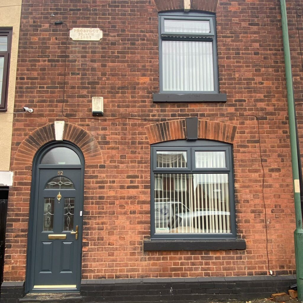 Windows and Doors sprayed on the front and rear of this property....